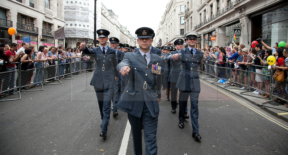 © Licensed to London News Pictures. LONDON, UK  02/07/11. Members of the Royal Air Force march in London's Pride March. 21 floats and around a million people flocked to Central London for the festival which celebrates the diversity within the LBGT (lesbian, gay, bisexual and transgender) community.  Please see special instructions for usage rates. Photo credit should read Matt Cetti-Roberts/LNP