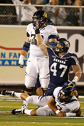 September 17, 2010; Reno, NV, USA; California Golden Bears quarterback Kevin Riley (13) is sacked by Nevada Wolf Pack defensive tackle Brett Roy (47) during the second quarter at Mackay Stadium. Nevada defeated California 52-31.