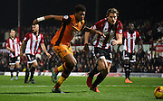 Chuba Akpom and James Tarkowski chase for the loose ball during the Sky Bet Championship match between Brentford and Hull City at Griffin Park, London, England on 3 November 2015. Photo by Michael Hulf.