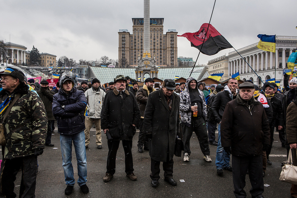 KIEV, UKRAINE - DECEMBER 6: Anti-government protesters listen to speeches on Independence Square on December 6, 2013 in Kiev, Ukraine. Thousands of people have been protesting against the government since a decision by Ukrainian president Viktor Yanukovych to suspend a trade and partnership agreement with the European Union in favor of incentives from Russia. (Photo by Brendan Hoffman/Getty Images) *** Local Caption ***