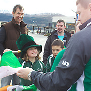 """Brian O""""Driscoll signs an autograph for Milly Robinson, 8, from Tarras School near Wanaka as the Irish Rugby Team arrive at Queenstown airport, for the IRB Rugby World Cup 2011, Queenstown, New Zealand, 1st September 2011. Photo Tim Clayton..."""