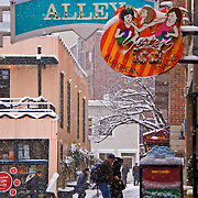 Post Alley at the Pike Place Market during winter snow storm, Seattle, Washington
