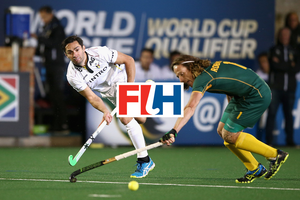 JOHANNESBURG, SOUTH AFRICA - JULY 17: Loick Luypaert of Belgium shoots as Jonathan Robinson of South Africa attempts to block during the Group B match between South Africa and Belgium on day five of the FIH Hockey World League - Men's Semi Finals on July 17, 2017 in Johannesburg, South Africa.  (Photo by Jan Kruger/Getty Images for FIH)