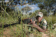 Nkwe wildlife security services offer a paramilitary - style rhino protection service that operates in the several private game reserves in the Limpopo area of South Africa..Nkwe's recruits undergo a basic two week training program focusing on military discipline and endurance to become a field ranger. From this stage the field rangers may be selected for an advance course that focuses on firearms and tactical training. Once this is completed they will be given rank and go on armed patrol to protect the rhinos...Pic shows: Qualified Corporals Habile Sithebe and Evans Maluleke out patrolling the area in order to  protect the rhinos...Nkwe Wildlife Security Services based in the Lapalala Wilderness Area, Limpopo, South Africa...© Zute Lightfoot