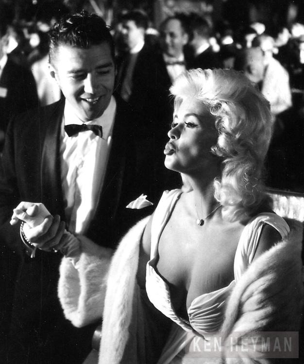 Jayne Mansfield attending opening night of the Metropolitan Opera in New York.
