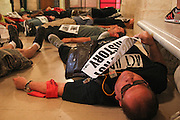 "Manhattan, NY. 10/4/2013 – Activists from ACT/UP NY stage a ""die in"" at the New York Public Library in conjunction with the opening of the ""Why We Fight: Remembering AIDS Activism"" exhibition. 10/4/2013. Photo by Nicholas Wells/NYCity Photo Wire"