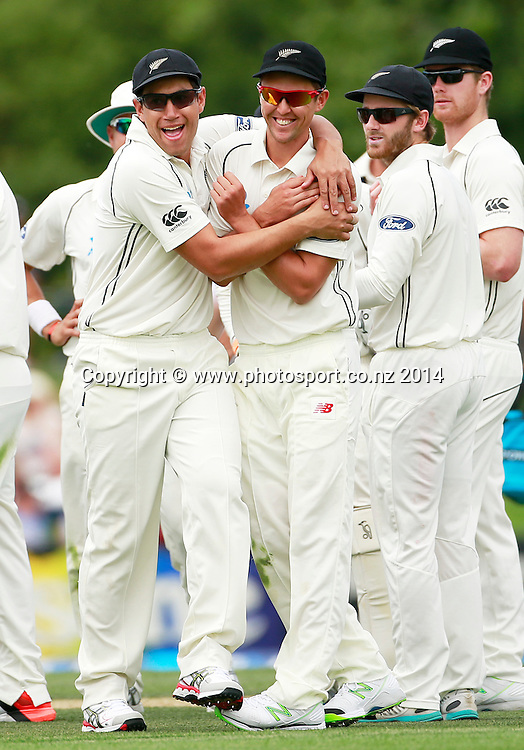 Ross Taylor of the Black Caps and Trent Boult react to a Sri Lankan wicket on Day 2 of the boxing Day Cricket Test Match between the Black Caps v Sri Lanka at Hagley Oval, Christchurch. 27 December 2014 Photo: Joseph Johnson / www.photosport.co.nz