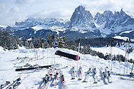 A snowy view of Sassolungo and Sassopiato Mountains behind the Alpe di Siusi ski area in the Dolomites near the village of Ortisei, Italy