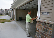 Kevin Hunter of Hunter Appraisal Service closes the garage door after reviewing a new construction home at 403 Cimarron Drive, in Hiawatha on Friday morning, June 29, 2012.