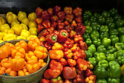View of multicolored bell peppers on display in market