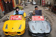 ZHENGZHOU, CHINA - FEBRUARY 21: <br /> <br /> Chinese Farmer Makes Miniature Lamborghini <br /> <br /> A farmer called Guo Liangyuan drives his miniature Lamborghini on the street on February 21, 2017 in Zhengzhou, Henan Province of China. Chinese farmer Guo Liangyuan has made three Lamborghini replicas for his grandson. The upgraded version of his miniature Lamborghini could drive as far as about 60 miles when fully charged as these Lamborghini replicas are electric-powered cars. <br /> ©Exclusivepix Media