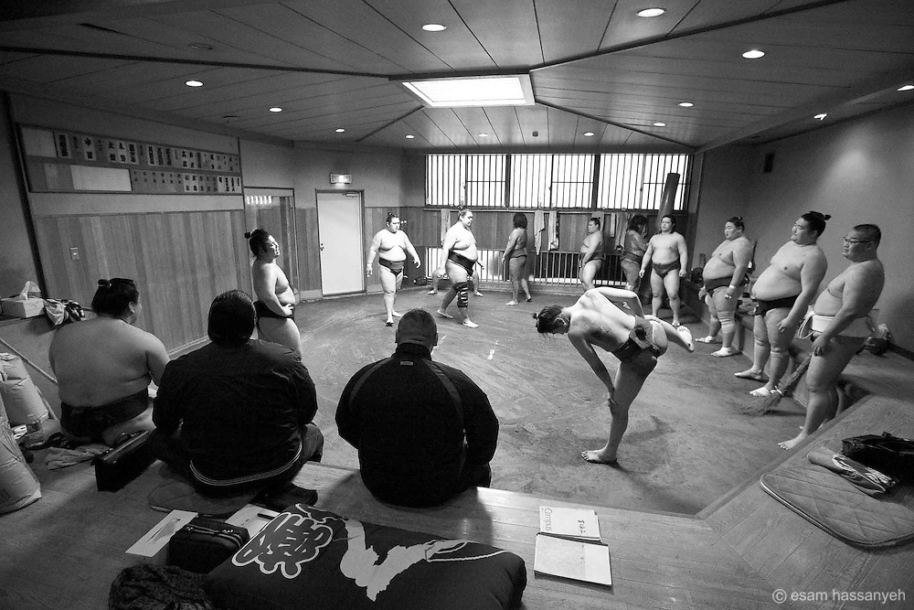 Daily sumo practice is underway in the keikoba (sumo practice area)  and is performed in a disciplined and strictly regimental environment.<br />