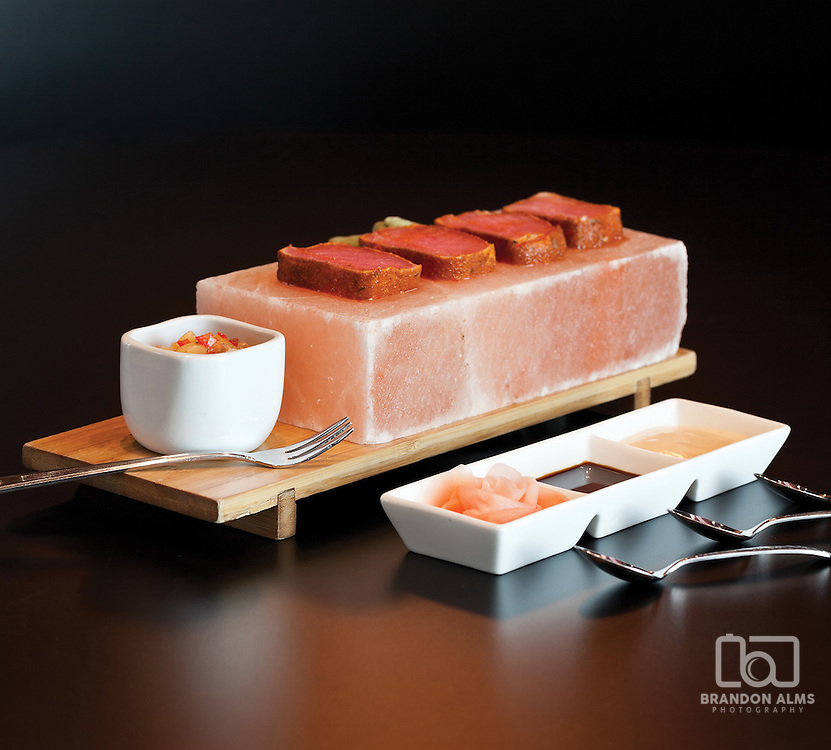Pan-Seared Hawaiian Ahi Tuna served on a Himalayan pink salt slab from Level 2 Steakhouse in Branson, MO. Photo by Brandon Alms Photography