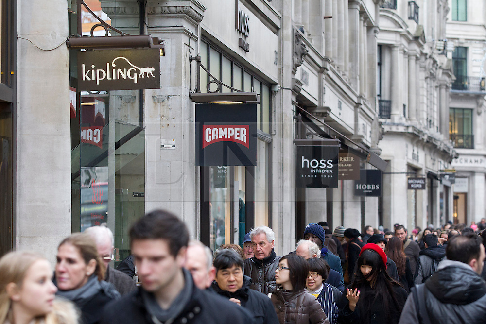 © Licensed to London News Pictures. 26/12/2013. London, UK. Shoppers search for bargains on Regent Street during the Boxing Day sales in London today (26/12/2013). Photo credit: Matt Cetti-Roberts/LNP