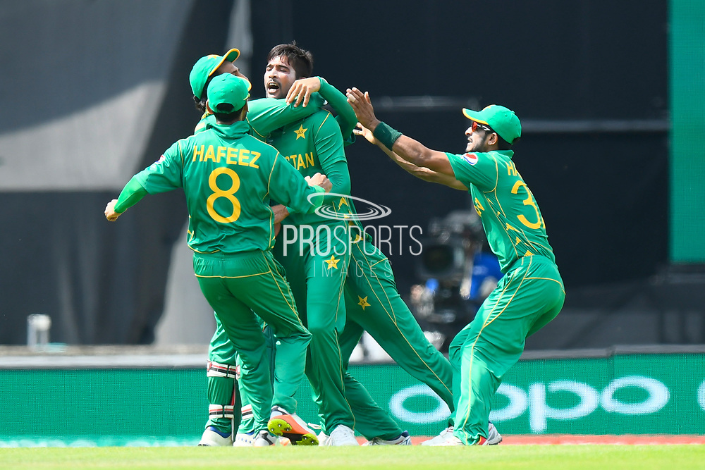 Wicket - Mohammad Amir of Pakistan celebrates taking the wicket of Virat Kohli (captain) of India during the ICC Champions Trophy final match between Pakistan and India at the Oval, London, United Kingdom on 18 June 2017. Photo by Graham Hunt.