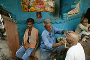 The main mourner, usually the eldest son or closest male family member, prepares for cremation rituals by getting his head and face shaved. There are a prescribed set of rituals for the entire process that started at the family's home with the washing of the body and wrapping for the travel to the burning ghats. The main mourner's hair and facial hair is shorn, (cost 15 rupees, by one of the many barbers near the ghats) and his nails are cut. Family members at home also are shaved and cut.