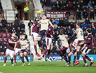 12th December 2017, Tynecastle Park, Edinburgh, Scotland; Scottish Premier League football,  Heart of Midlothian versus Dundee; Dundee's Josh Meekings rises above the Hearts defence