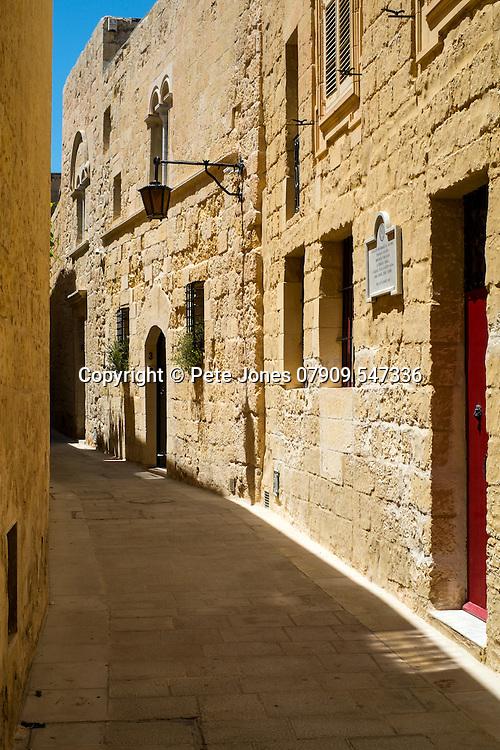 Narrow street alley in Mdina, Rabat,<br />Malta, Europe.<br />Summer 2016.