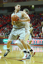 22 February 2012:  Garret Stutz tries to work his way past Jordan Threloff during an NCAA Missouri Valley Conference mens basketball game between the Wichita State Shockers and the Illinois State Redbirds in Redbird Arena, Normal IL