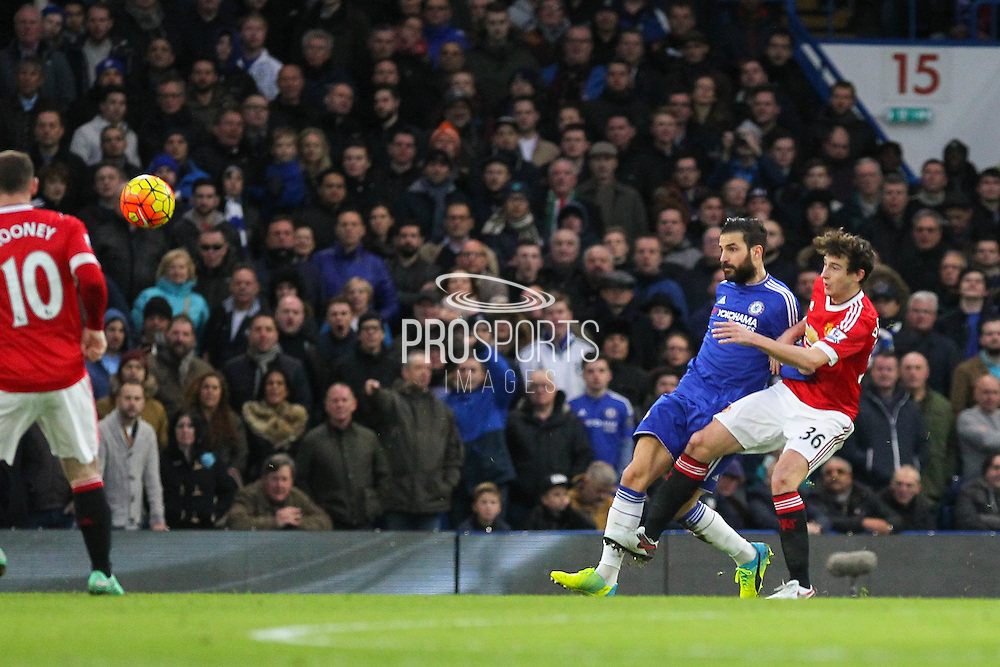 Chelsea's Cesc Fabregas and Matteo Darmian of Manchester United battle during the Barclays Premier League match between Chelsea and Manchester United at Stamford Bridge, London, England on 7 February 2016. Photo by Phil Duncan.