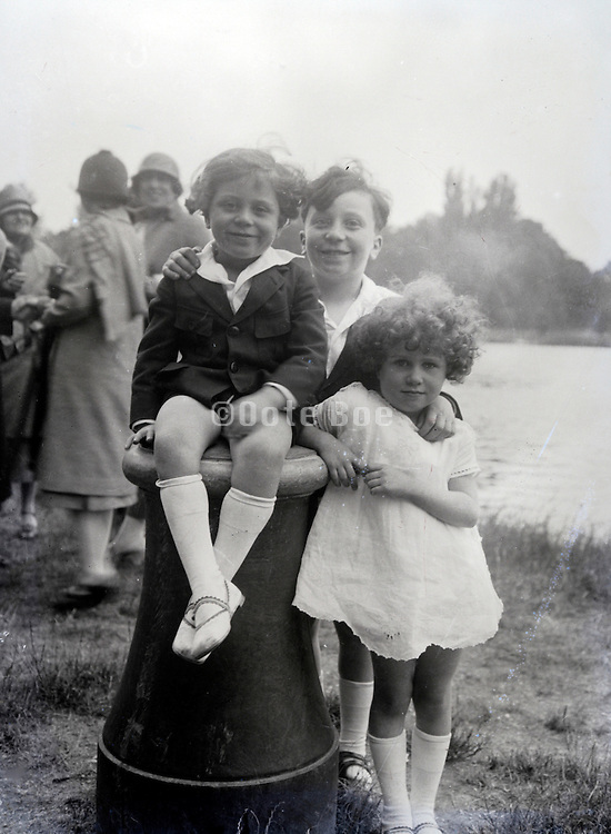 smiling children posing on a day outside 1930s