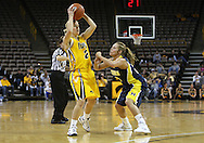 26 JANUARY 2009: Iowa guard Kamille Wahlin (2) is defended by Michigan guard Courtney Boylan (20) during the first half of an NCAA women's college basketball game Monday, Jan. 26, 2009, at Carver-Hawkeye Arena in Iowa City, Iowa. Iowa defeated Michigan 77-69.