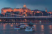 Elisabeth Bridge, Castle Mountain and excursion boats on the Danube at sunset...M.S. Johann Strauss, a brand new four star+ river cruiser operated by Austrian River Cruises, and chartered by Club 50 (a travel agency especially for seniors aged 50 and up) undertook an epic 3-week journey (May 21 to June 10, 2004) all the way from Amsterdam to the Black Sea?along Rhine, Main and Danube?, presumably the first passenger vessel ever to have done so. This is one of the images recorded during this historic voyage.