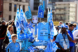 Manchester City merchandise for sale during the trophy parade in Manchester.