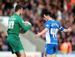 Ian Henderson of Rochdale stops Daniel Bachmann of Bury from clearing the ball upfield - Mandatory byline: Matt McNulty/JMP - 06/12/2015 - Football - Spotland Stadium - Rochdale, England - Rochdale v Bury - FA Cup