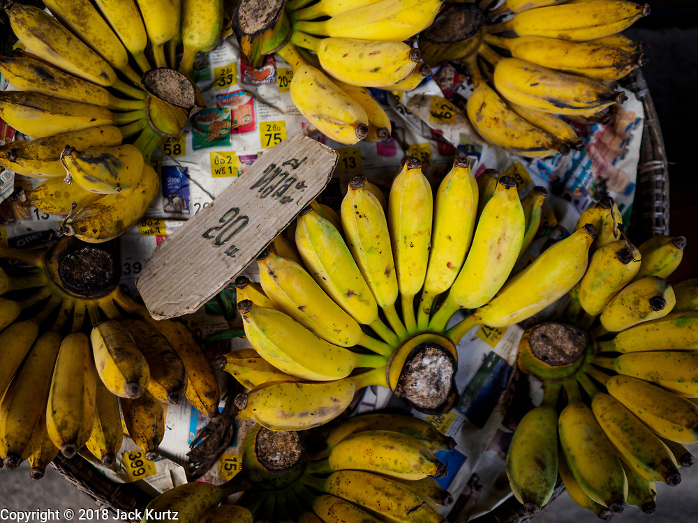 22 DECEMBER 2018 - CHANTABURI, THAILAND:  Bananas for sale in Chantaburi. Chantaburi is the capital city of Chantaburi province on the Chantaburi River. Because of its relatively well preserved tradition architecture and internationally famous gem market, Chantaburi is a popular weekend destination for Thai tourists.         PHOTO BY JACK KURTZ