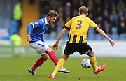 Portsmouth defender Danny East takes on Shrewsbury Town defender Mickey Demetriou during the Sky Bet League 2 match between Portsmouth and Shrewsbury Town at Fratton Park, Portsmouth, England on 28 March 2015.