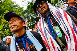 © Licensed to London News Pictures. 16/05/2014. PDRC protestor guards keep a look out during a rally outside Parliament in Bangkok Thailand where key senators were holding a meeting on May 16, 2014.  Photo credit : Asanka Brendon Ratnayake/LNP