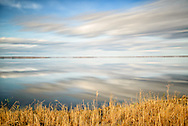 long exposure over Lake Mattamuskeet with mirror image of clouds
