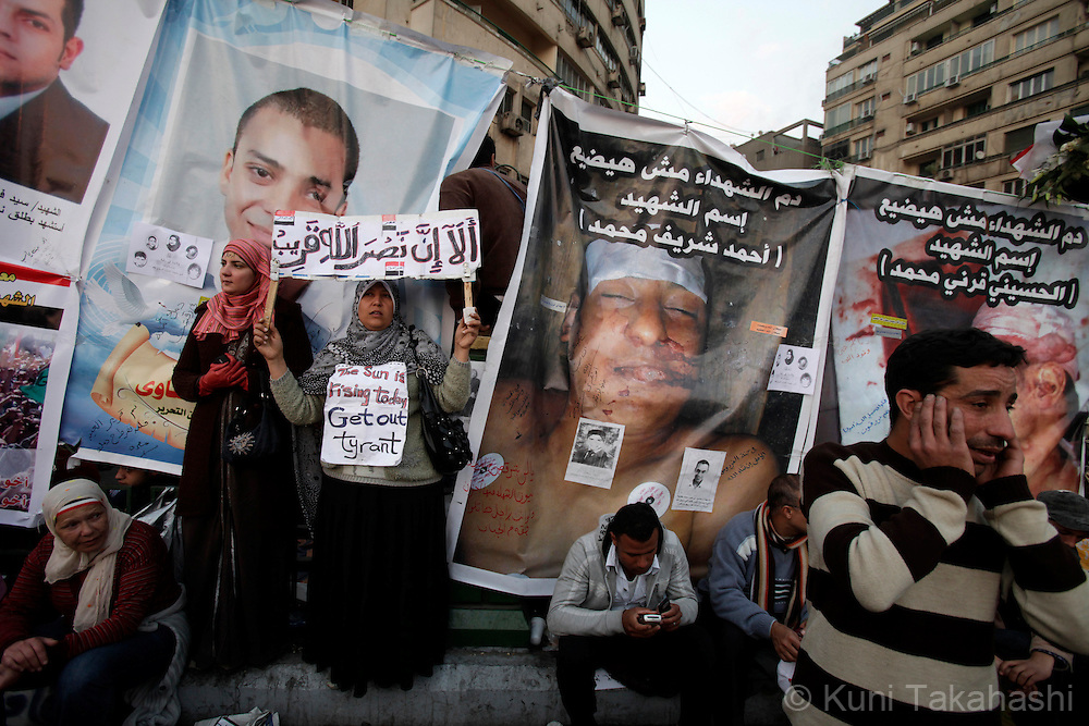 Anti-government protesters in front of posters of victims during uprise at Tahrir Sq in Cairo Egypt on Feb 11, 2011 demanding President Hosni Mubarak to step down. .Photo by Kuni Takahashi