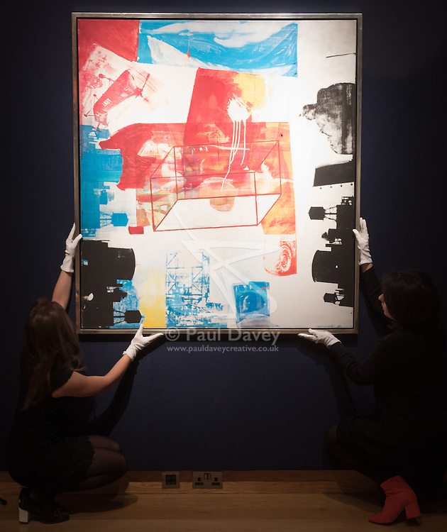 Christie's, London, March 3rd 2017. PICTURED: Gallery staff straighten Robert Rauschenberg's 'Transom', oil and silkscreen ink on canvas, painted in 1963, which is expected to fetch between £4-6 million. <br /> Fine art auctioneers Christies hold a press preview for their Post-War and Contemporary Art auctions to be held on March 7th and 8th.