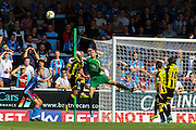Jon McLaughlin punches the ball away during the Sky Bet League 1 match between Burton Albion and Scunthorpe United at the Pirelli Stadium, Burton upon Trent, England on 8 August 2015. Photo by Aaron Lupton.