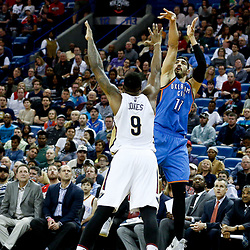 Jan 25, 2017; New Orleans, LA, USA; Oklahoma City Thunder center Enes Kanter (11) shoots over New Orleans Pelicans forward Terrence Jones (9) during the first quarter of a game at the Smoothie King Center. Mandatory Credit: Derick E. Hingle-USA TODAY Sports