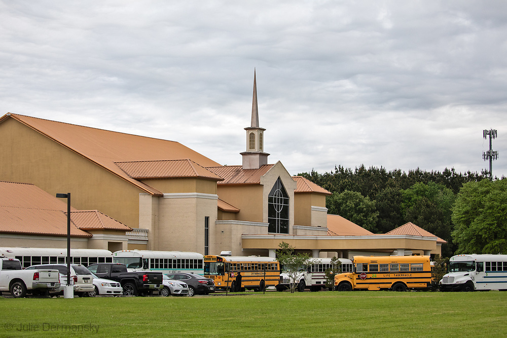 Sunday, March 29, 202, Buses waiting for Congregants to depart the Life Tabernacle Church after atteneding a service led by Pastor Tony Spell who defied Louisiana Gov. John Bel Edwards shelter-in-place order despite the coronavirus Pandemic.  None of the busses appeared full. Most had tinted windows.