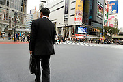 businessman crossing Hachiko intersection at Shibuya station