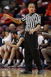 16 November 2014:  Referee Verne Harris directs traffic after a foul call during an NCAA non-conference game between the Utah State Aggies and the Illinois State Redbirds.  The Aggies win the competition 60-55 at Redbird Arena in Normal Illinois.