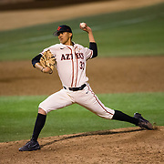 24 February 2018: The San Diego State Aztec baseball team competes in day two of the Tony Gwynn legacy tournament against #4 Arkansas. San Diego State Aztecs pitcher Christian Winston (33) seen here pitching in the top of the ninth inning against Arkansas. The Aztecs dropped a close game to the Razorbacks 4-2. <br /> More game action at sdsuaztecphotos.com