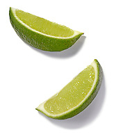 2 lime slices on white background