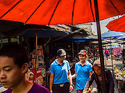 28 FEBRUARY 2014 - MAE SOT, TAK, THAILAND:  Burmese people walk through the market in Mae Sot. Mae Sot is on the Thai-Myanmar border. The market is a mix of Thai and Burmese businesses.   PHOTO BY JACK KURTZ