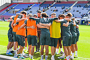 Leeds United players huddle in the warm up during the EFL Sky Bet Championship match between Wigan Athletic and Leeds United at the DW Stadium, Wigan, England on 17 August 2019.