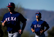 The sun hits Texas Rangers starting pitcher Yu Darvish (11, right) as he runs with other pitchers during a spring training workout at the team's training facility on Tuesday, February 15, 2017 in Surprise, Arizona. (Ashley Landis/The Dallas Morning News)