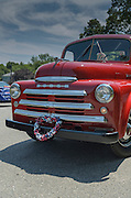 Niantic, Connecticut, July 4, 2012 - Residents celebrate Independence Day with the 40th Annual Black Point Beach Club Parade. Many classic red trucks such as this classic Dodge decorated with American flags were in evidence during the parade.