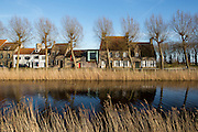 Modern architecture fits in neatly with the old, along the canal at Damme, near Bruges