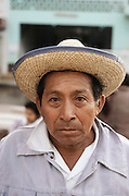 Man with Mayan features wearing a straw sombrero in a market in Campeche, Mexico.
