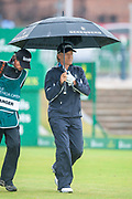 Bernhard Langer shelters from the rain during the final round of the Rolex Senior Golf Open at St Andrews, West Sands, Scotland on 29 July 2018. Picture by Malcolm Mackenzie.