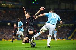 MANCHESTER, ENGLAND - Wednesday, March 24, 2010: Everton's Tim Cahill is brought down by Manchester City's Gareth Barry, Everton score the opening goal from the resulting free-kick during the Premiership match at the City of Manchester Stadium. (Photo by David Rawcliffe/Propaganda)